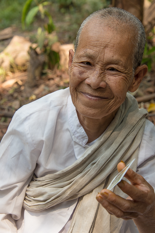 nun at kulen mountain, cambodia